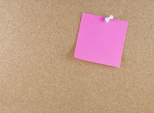 Colorful sticky note. Colorful sticky blank note attached to a corkboard white thumbtack Royalty Free Stock Images