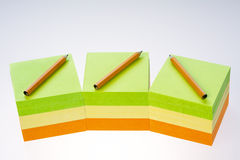 Colorful sticky note pads stacked Royalty Free Stock Photos
