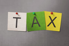 Colorful sticky note with TAX text with red pin thumbtack Royalty Free Stock Photography