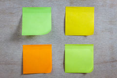 Colorful sticky note on wood background. The colorful sticky note on wood background stock images