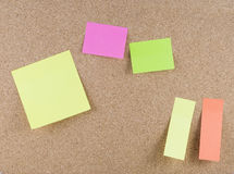 Colorful sticky notes. Attached to a corkboard Stock Photography