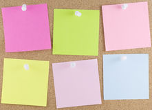 Colorful sticky notes. Attached to a corkboard with white thumbtacks Stock Image