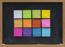 Colorful sticky notes on blackboard Stock Photo