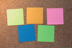 Colorful sticky notes. On a cork board Royalty Free Stock Images