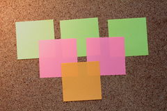 Colorful sticky notes. On a cork board Royalty Free Stock Photo