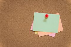 Colorful sticky notes on cork bulletin board. With copy space for design Royalty Free Stock Photography