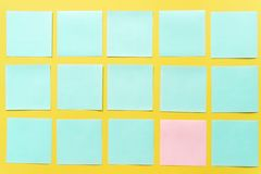 Colorful sticky notes on a free yellow background space stock photo