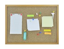 Colorful sticky notes, pin, key and tag name on cork board Stock Photo