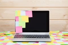 Colorful sticky notes stuck to a laptop screen stock photo