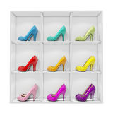 Colorful stiletto high heel shoes exhibited on white shelf, isolated on white background Royalty Free Stock Photo