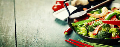 Colorful stir fry in a wok. Chinese cuisine. Colorful stir fry in a wok. Shrimps with vegetables royalty free stock image