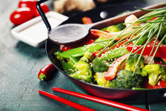 Colorful stir fry in a wok Stock Photo