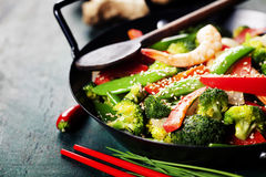 Colorful stir fry in a wok. Chinese cuisine. Colorful stir fry in a wok. Shrimps with vegetables Royalty Free Stock Photography