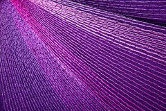 Colorful Stitching Forming Pattern on Mauve Fabric Stock Image