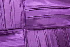 Colorful Stitching Forming Pattern on Mauve Fabric Stock Images