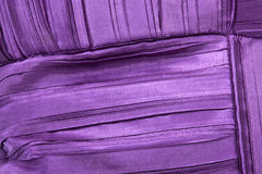 Colorful Stitching Forming Pattern on Mauve Fabric Royalty Free Stock Images