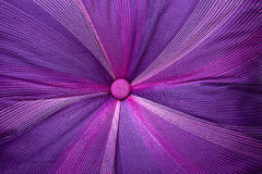 Colorful Stitching Forming Pattern on Mauve Fabric Royalty Free Stock Image