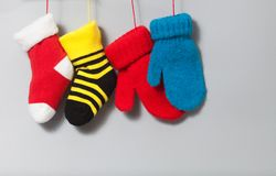 Colorful stocking christmas socks mittens on gray background. bright xmas design decoration element. red, yellow, green Stock Photography