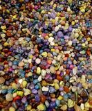 Colorful semiprecious round stones background royalty free stock images