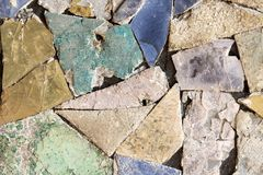 Colorful stone mosaic with chaotic pattern, seamless background photo texture. Royalty Free Stock Images