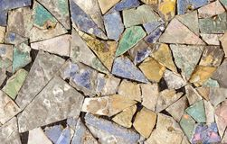Colorful stone mosaic with chaotic pattern, seamless background photo texture. Stock Images