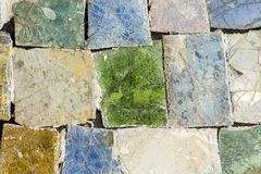 Colorful stone mosaic with chaotic pattern, seamless background photo texture. Royalty Free Stock Photos