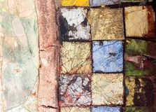 Colorful stone mosaic with chaotic pattern, seamless background photo texture. Stock Image