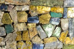 Colorful stone mosaic with chaotic pattern, seamless background photo texture. stock photo