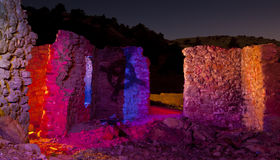 Colorful Stone Ruins. Washington, Nevada, Lit with multiple bursts of colored light.  Stone ruins at Night Royalty Free Stock Image