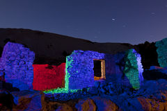 Colorful Stone Ruins at Night. Washington, Nevada, Lit with multiple bursts of colored light.  Stone ruins at Night Royalty Free Stock Photography