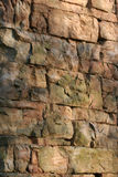 Colorful Stone Wall. An old, hand-constructed stone wall stock photo