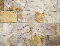 Colorful stone wall Stock Images