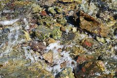 Colorful stones, hard rocks trasparent sea water, landscape Stock Photography