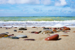 Colorful stones on sand beach Stock Photo