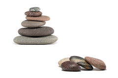 Colorful Stones and Stone Cairn Isolated on White stock images
