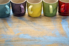 Colorful stoneware coffee cups Stock Images