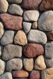 Colorful stonework in wall Stock Images