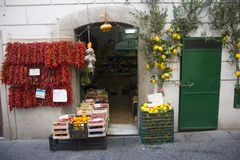 Colorful storefront with flowers in Amalfi, a town in the province of Salerno, in the region of Campania, Italy, on the Gulf of Sa Stock Image