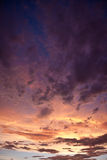 Colorful stormy sky. Colorful dramatic storm clouds at sunset Stock Images