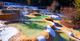 Colorful stratum of carbonic acid rock, tufa water. At Huanglong National Park, Sichuan, China Stock Images