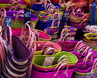 Colorful straw bags in a street market Royalty Free Stock Image