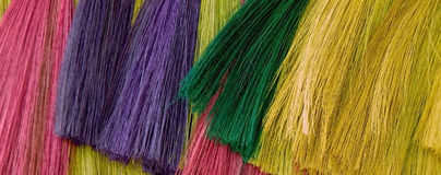 Colorful Straw Brooms Stock Photos