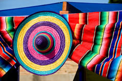 Colorful straw hat and blanket Stock Images