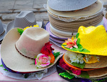 Colorful straw hats stacked in an outdoor Stock Images