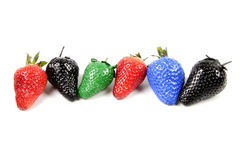 Colorful strawberry. Some painted colorful strawberry isolated on white background Royalty Free Stock Photo