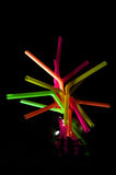 Colorful Straws. A bunch of colorful straws glowing in the dark Stock Photo