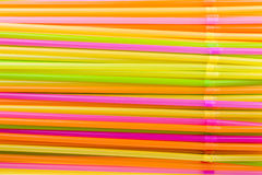 Colorful straws. Arranged colorful straws in a glass stock photos