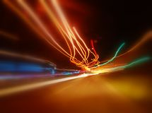 Colorful Streaks. An abstract background formed by the colorful lights in motion on a highway at night Stock Images