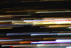 Colorful Streaks of Light. Angeled downward with lots of black space Stock Photos