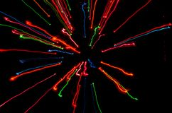 Colorful streaks of light moving to center stock photo